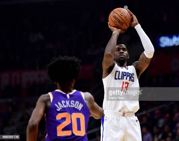 Jamil Wilson of the LA Clippers scores on a jumper over Josh Jackson of the Phoenix Suns during the first half at Staples Center on December 20 2017...