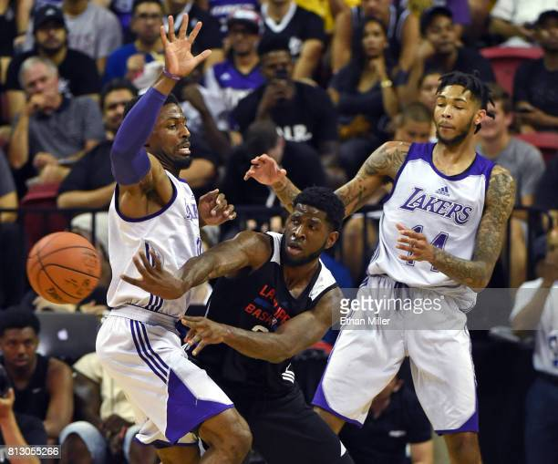 Jamil Wilson of the Los Angeles Clippers passes under pressure from David Nwaba and Brandon Ingram of the Los Angeles Lakers during the 2017 Summer...