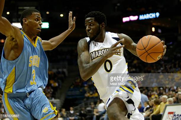 Jamil Wilson of the Marquette Golden Eagles drives to the rim during the first half of play against the Southern Jaguars at BMO Harris Bradley Center...