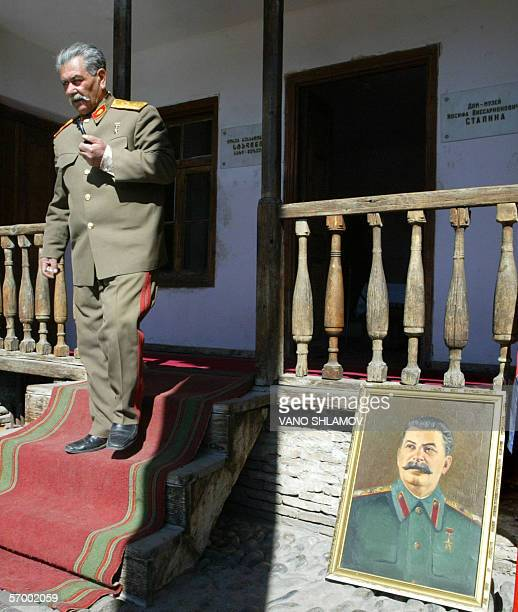 Jamil Ziadaliyev a double of former Soviet dictator Joseph Stalin walks out of Stalin's birth house during celebrations for the 53rd anniversary of...