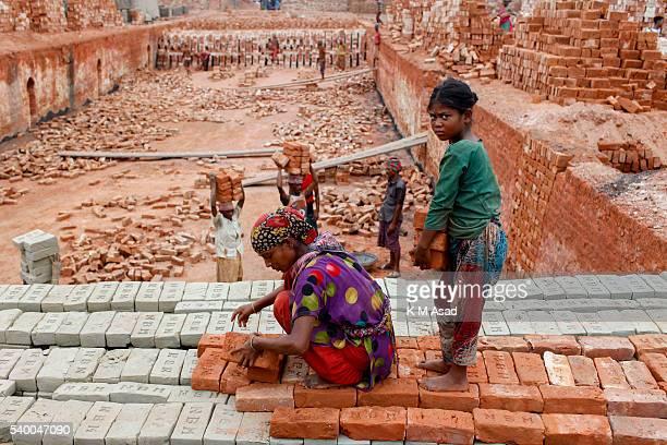 NARAYANGONJ DHAKA BANGLADESH Jamila works at a brick factory in Narayangonj Bangladesh June 01 2016 She come this place with her family member This...