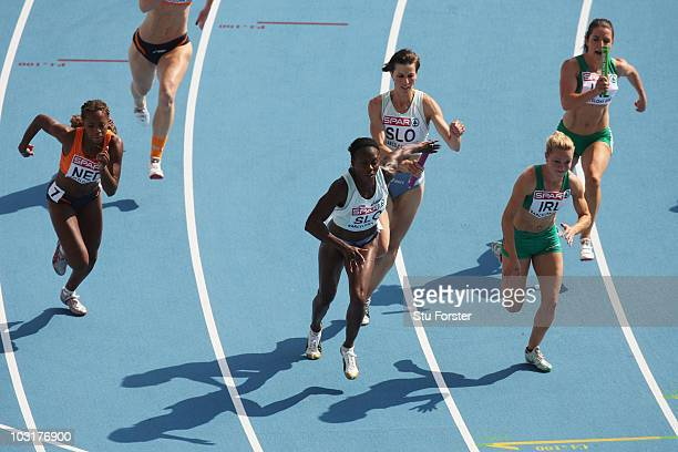 Jamile Samuel of Netherlands Merlene Ottey of Slovenia and Ailis Mcsweeney of Ireland compete in the 4x100m Womens Relay Heats during day five of the...