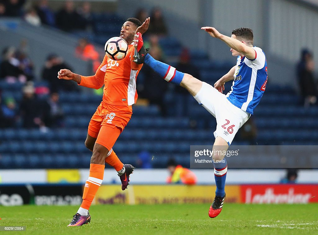 Jamille Matt of Blackpool and Darragh Lenihan of Blackburn Rovers compete for the ball during the Emirates FA Cup Fourth Round match between Blackburn Rovers and Blackpool at Ewood Park on January 28, 2017 in Blackburn, England.