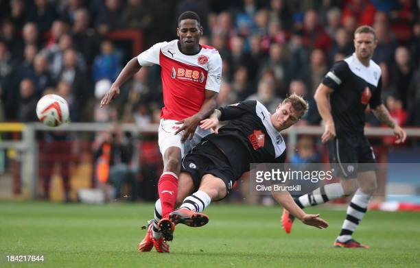 Jamille Matt of Fleetwood Town is tackled by Liam Cooper of Chesterfield during the Sky Bet League Two match between Fleetwood Town and Chesterfield...