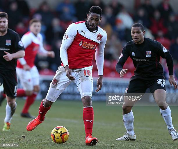 Jamille Matt of Fleetwood Town looks to play the ball watched by Mathias KouoDoumbe of Northampton Town during the Sky Bet League Two match between...