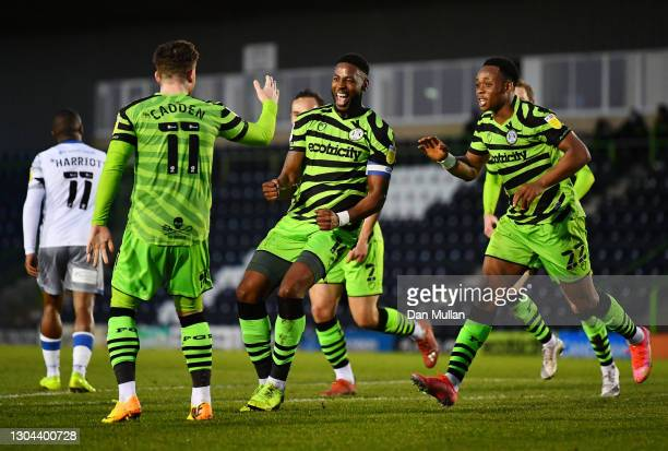 Jamille Matt of Forest Green Rovers celebrates with Nicky Cadden and Udoka Godwin-Malife after scoring his sides second goal during the Sky Bet...