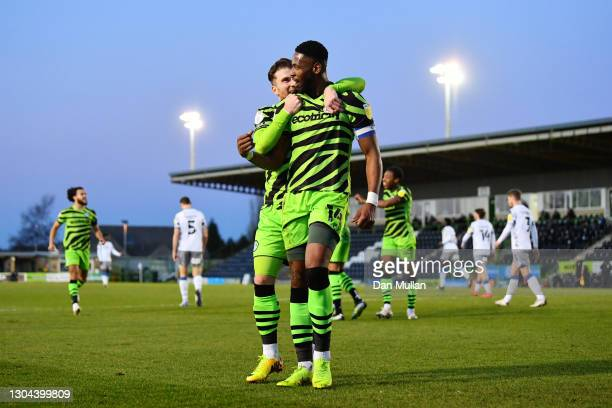 Jamille Matt of Forest Green Rovers celebrates with teammate Nicky Cadden after scoring his team's first goal during the Sky Bet League Two match...