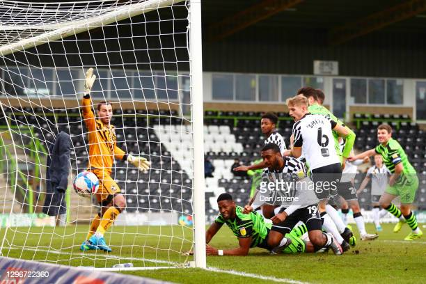 Jamille Matt of Forest Green Rovers watches as the ball crosses the line from a freekick taken by team-mate Nicky Cadden of Forest Green Rovers...
