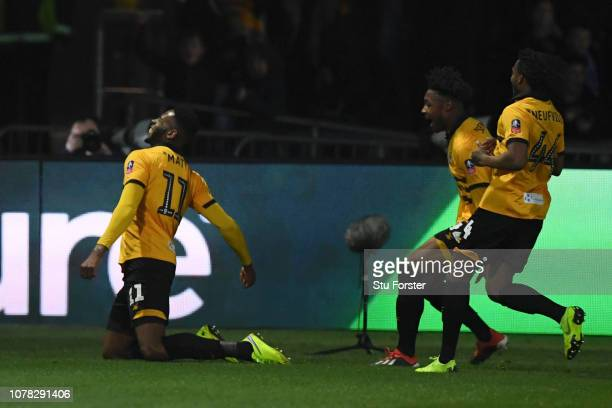 Jamille Matt of Newport County celebrates with team mates after scoring his team's first goal during the FA Cup Third Round match between Newport...