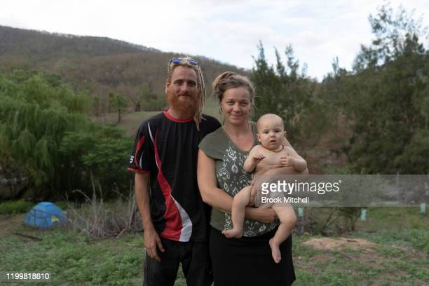 Jamille Noxgray Rachel Noonan and their daughter Manuka pose on their property on January 14 2020 in Wytaliba Australia The family have returned to...