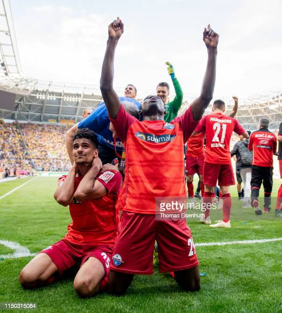 Jamilu Collins and Mohamed Draeger of Paderborn celebrate after the Second Bundesliga match between SG Dynamo Dresden and SC Paderborn 07 at...