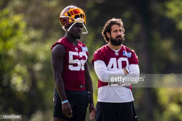 Jamin Davis and Joe Walker of the Washington Football Team look on during mandatory minicamp at Inova Sports Performance Center on June 10, 2021 in...