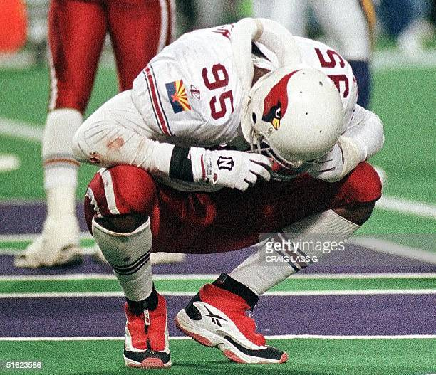 Jamir Miller of the Arizona Cardinals crouches dejected after a Minnesota Vikings touchdown 10 January during their NFC Divisional playoff game at...