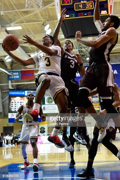 Jamir Moultrie of the La Salle Explorers drives to the basket against Jaylen Adams and LaDarien Griffin of the St Bonaventure Bonnies during the...