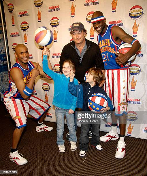 Jamison Belushi gets a little help with ball spinning from Scooter Christensen and Special K Daley with her dad Jim Belushi and her little brother...