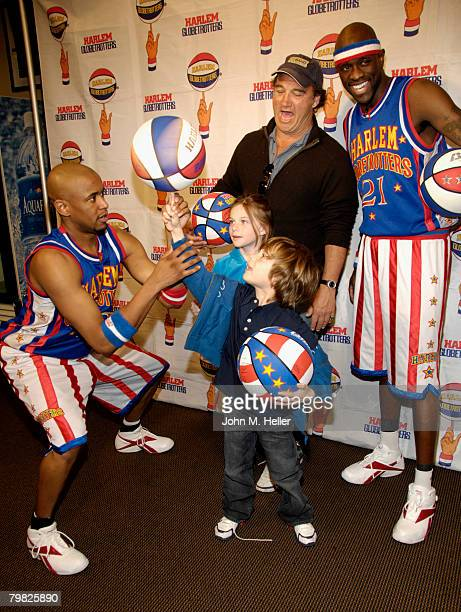 Jamison Belushi watches her little brother get a little help with ball spinning from Scooter Christensen and Special K Daley with her dad Jim Belushi...