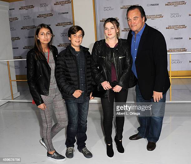 Jamison Bess Belushi and actor Jim Belushi arrive for the Premiere Of Lionsgate's The Hunger Games Mockingjay Part 1 Arrivals held at Nokia Theatre...