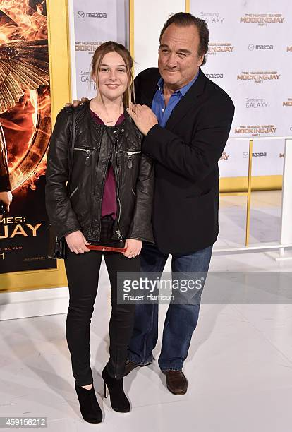 Jamison Bess Belushi and actor Jim Belushi attend the premiere of Lionsgate's The Hunger Games Mockingjay Part 1 at Nokia Theatre LA Live on November...