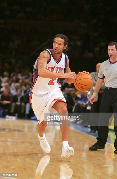 Jamison Brewer of the New York Knicks moves the ball against the Atlanta Hawks on November 23, 2004 at Madison Square Garden in New York City. The...
