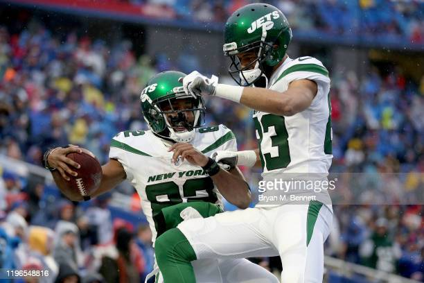 Jamison Crowder and Josh Malone of the New York Jets celebrate after scoring a touchdown during the fourth quarter of an NFL game against the Buffalo...