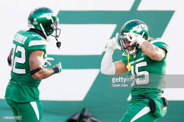 Jamison Crowder celebrates his touchdown with teammate Ty Johnson of the New York Jets in the third quarter against the Cleveland Browns at MetLife...