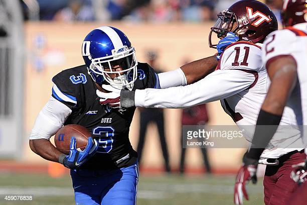 Jamison Crowder of the Duke Blue Devils runs against Kendall Fuller of the Virginia Tech Hokies during their game at Wallace Wade Stadium on November...