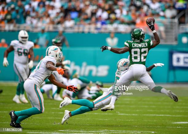 Jamison Crowder of the New York Jets makes a one handed catch against the Miami Dolphins in the first quarter at Hard Rock Stadium on November 03...