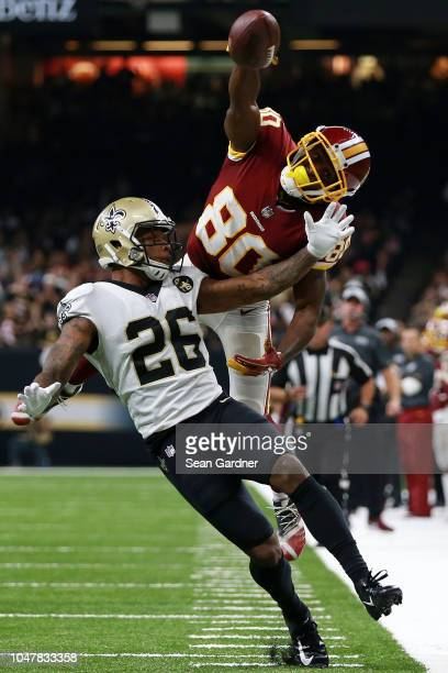 Jamison Crowder of the Washington Redskins attempts to catch the ball as P.J. Williams of the New Orleans Saints defends during the second half at...