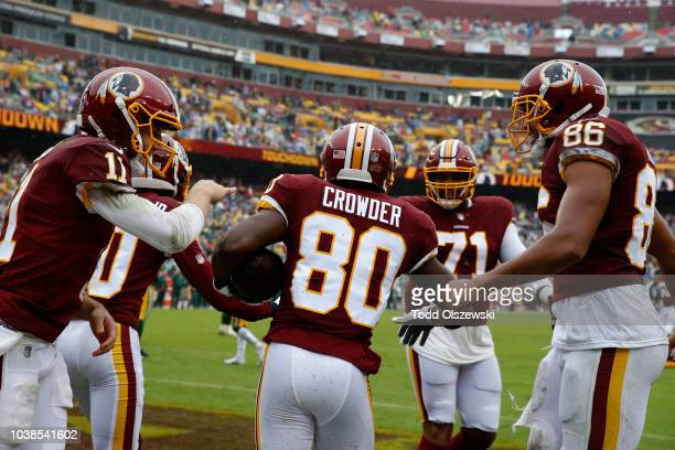 Jamison Crowder of the Washington Redskins celebrates with Alex Smith and Jordan Reed after a touchdown in the second quarter against the Green Bay...