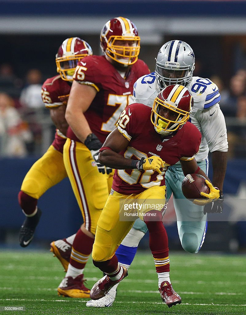 Jamison Crowder #80 of the Washington Redskins runs the ball against the Dallas Cowboys at AT&T Stadium on January 3, 2016 in Arlington, Texas.