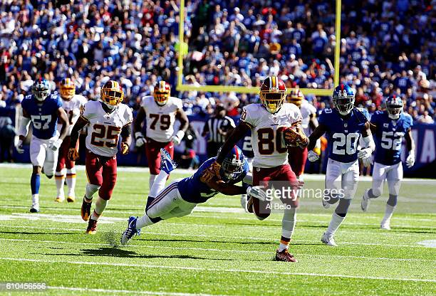 Jamison Crowder of the Washington Redskins scores a touchdown after Trevin Wade of the New York Giants misses the tackle in the third quarter during...