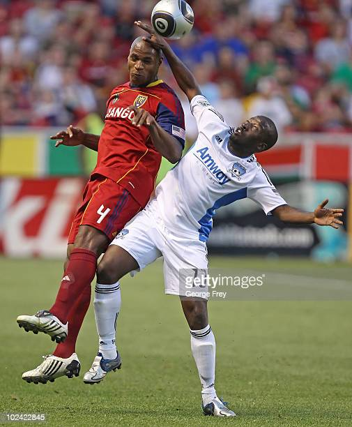 Jamison Olave of Real Salt Lake and Cornell Glen of San Jose Earthquakes fight for the ball during the second on June 25 2010 at Rio Tinto Stadium in...