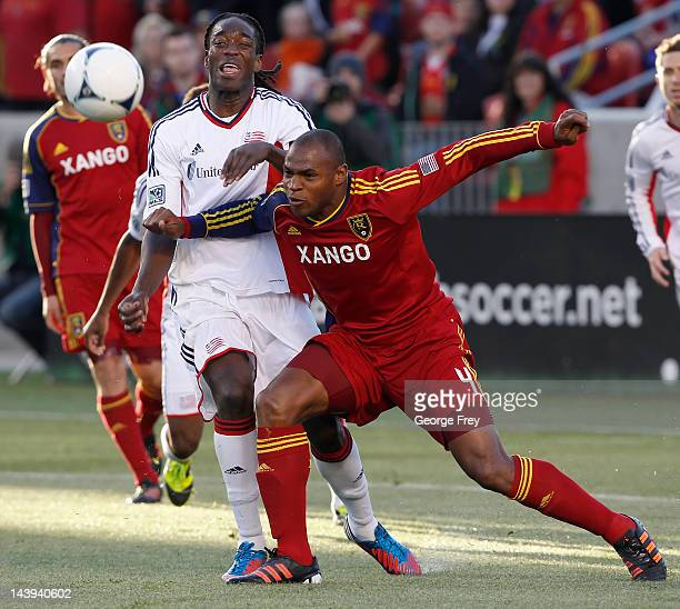 Jamison Olave of Real Salt Lake and Shairie Joseph of the New Engeland Revolution fight for the ball during the first half of an MLS soccer game May...