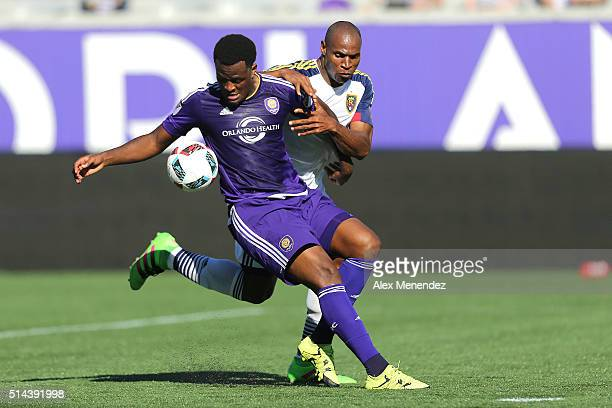 Jamison Olave of Real Salt Lake pulls on Cyle Larin of Orlando City SC during a MLS soccer match at the Orlando Citrus Bowl on March 6 2016 in...