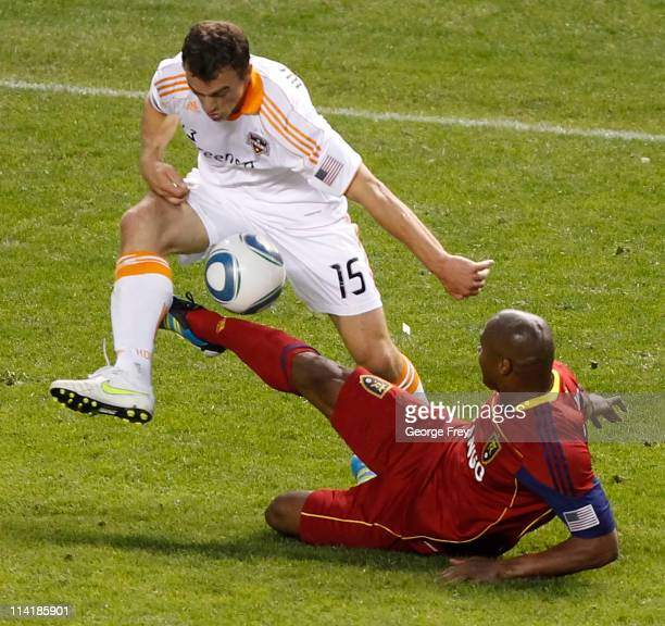 Jamison Olave of Real Salt Lake takes the ball from Cam Weaver of the Houston Dynamo during the second half of an MLS soccer game May 14 2011 at Rio...