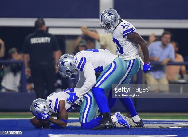 Jamize Olawale and Michael Gallup celebrate the first quarter touchdown by Tavon Austin of the Dallas Cowboys against the New York Giants at ATT...
