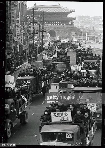 Jammed into trucks South Korean Labor Union members carry anticommunist placards as they motorcade through a street in Seoul denouncing North Korea...