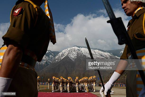 Jammu and Kashmir Armed Police personnel participate in their passing out parade at the Sheeri training centre, some 65 km northwest of Srinagar, on...