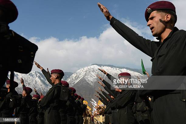 Jammu and Kashmir Armed Police personnel take an oath during their passing out parade at the Sheeri training centre, some 65 km northwest of...