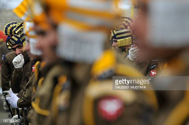 Jammu and Kashmir Armed Police warms up his hands during a Republic Day parade at the Bakshi stadium in Srinagar on January 26, 2012. Republic Day...