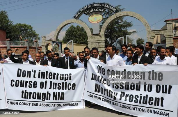 Jammu and Kashmir Bar Association members holding banners reading Dont interrupt course of justice through NIA during an antiNIA protest against...
