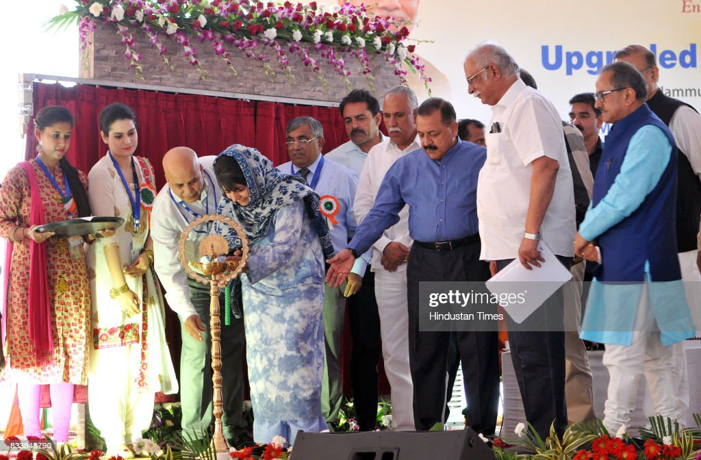 Jammu and Kashmir Chief Minister Mehbooba Mufti along with Union Minister for Civil Aviation P. Ashok Gajapathi Raju and other senior BJP leaders lights the lamp during the inauguration function of the upgraded terminal building at Jammu Airport, on August 17, 2017 in Jammu, India.