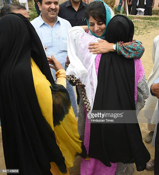 Jammu and Kashmir Chief Minister Mehbooba Mufti hugs a woman outside a polling booth in Ranbirpora during voting for Anantnag assembly seat...