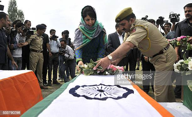 Jammu and Kashmir Chief Minister Mehbooba Mufti laying a wreath to pay tributes to the three serving policemen of Jammu & Kashmir force who were...