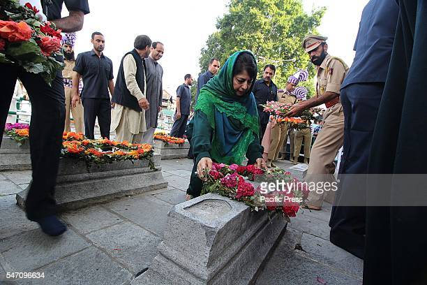 Jammu and Kashmir Chief Minister Mehbooba Mufti pays floral tributes on graves as she attends a ceremony to mark 84th anniversary of Martyr's Day in...