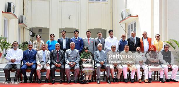 Jammu and Kashmir Chief Minister Mehbooba Mufti poses for a photograph along with other ministers from the People's Demoratic Party and the Bharatiya...