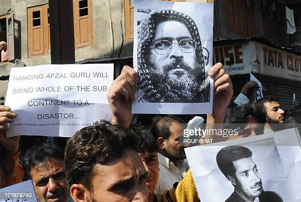 Jammu and Kashmir Liberation Front activists march during a protest against the death sentence on Afzal Guru in Srinagar on September 30 2011 Indian...