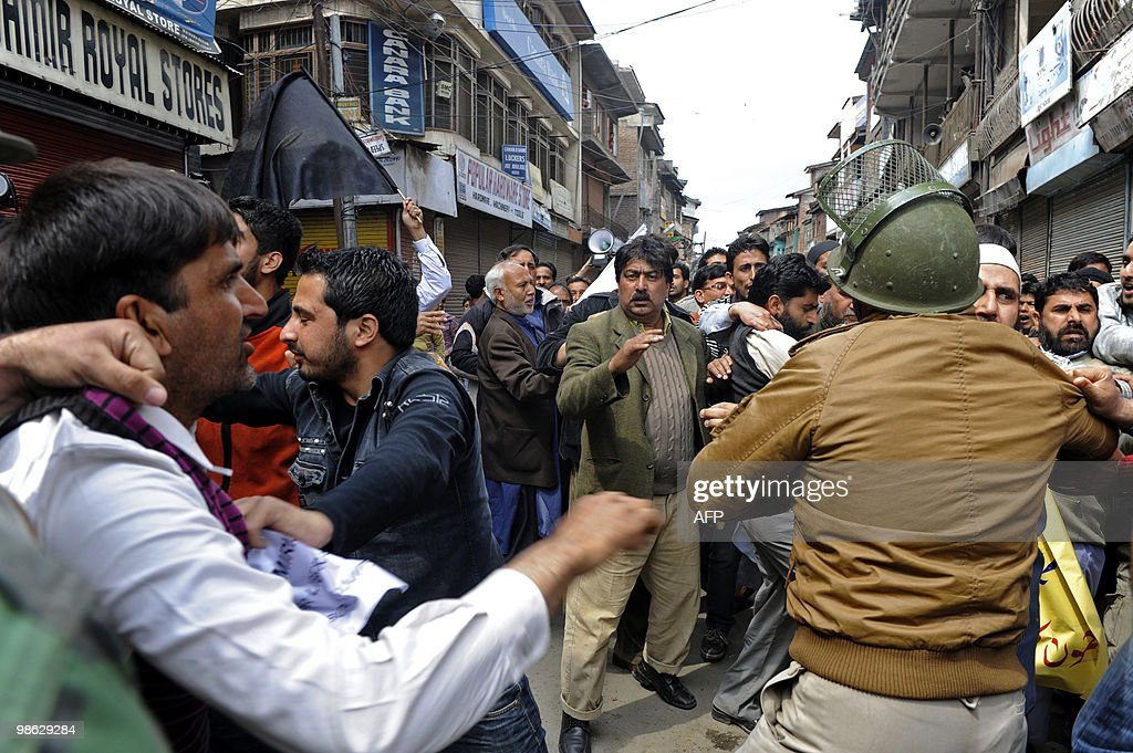 Jammu and Kashmir Liberation Front (JKLF) activists scuffle with Indian police during a protest in Srinagar on April 23, 2010. Police detained activists including the chairman of Jammu and Kashmir Liberation Front (JKLF) Yasin Malik during a protest against death sentences handed to three members of a Kashmiri group that bombed a New Delhi market in 1996. Life in Indian Kashmir was crippled by a one-day strike to protest the death sentences. On April 13, one person was killed and 24 hurt during a strike called to protest the initial convictions for the bombing, which left 13 dead and dozens injured in New Delhi's Lajpat Nagar shopping area. Anti-India insurgents have waged a two-decade fight against rule by New Delhi in the Himalayan region that has left more than 47,000 people dead, according to the official count.Seperatists put the toll twice as high. AFP PHOTO/Tauseef MUSTAFA