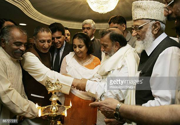 Jammu and Kashmir National Panthers Party Chairman Bhim Singh holds the hand of the Indianadministered Kashmir separatist leader Abdul Ghani Bhatt as...