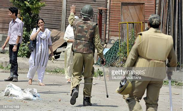 Jammu and Kashmir police stop a Kashmiri muslim family following the imposition of a curfew in downtown Srinagar on June 26, 2012. Parts of Srinagar...